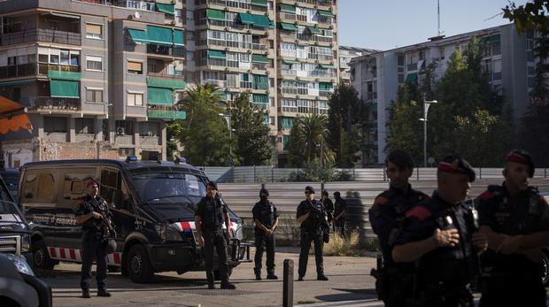 Catalan police officers cordon off the area following a knife attack at a police station (AP)