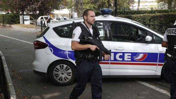 A police officer stands guard in Trappes (Michel Euler/AP)