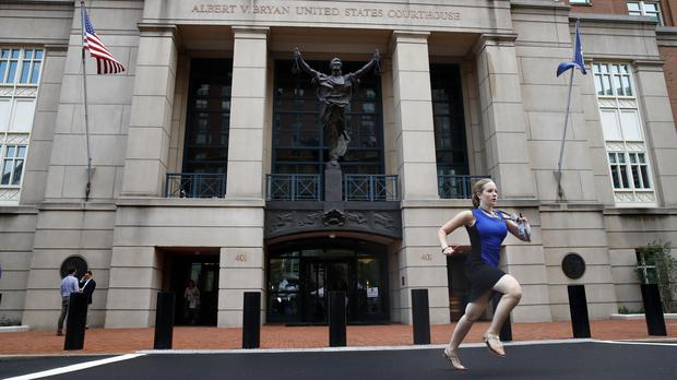 Cassie Semyon runs from the courthouse with results(Jacquelyn Martin/AP)