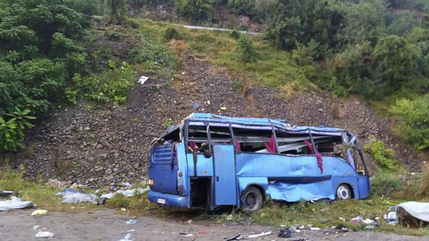 aaab67d9e3 At least 15 people dead after tourist bus plunges 20m off road in ...