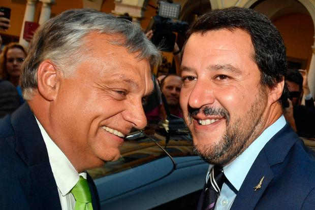 Together: Italy's interior minister Matteo Salvini, right, with Hungary's prime minister Viktor Orban, in Milan last week. Photo: Daniel Dal Zennaro/Ansa