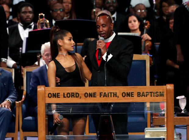 Apology: Pastor Charles Ellis said 'maybe I crossed the border' by hugging Ariana Grande above her waist after she performed at Aretha Franklin's funeral in Detroit. Photo: Reuters