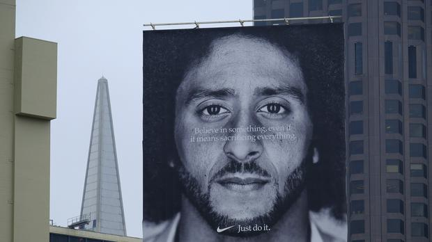 A billboard shows former San Francisco 49ers quarterback Colin Kaepernick above a Nike store at Union Square (Eric Risberg/AP)