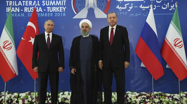 Vladimir Putin, Hassan Rouhani and Recep Tayyip Erdogan (Presidential Press Service via AP, Pool)