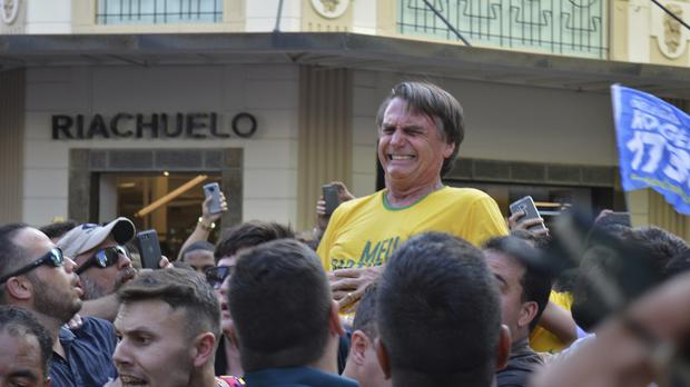 Jair Bolsonaro grimaces after being stabbed in the stomach (AP Photo/Raysa Leite)