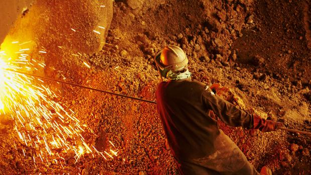 Mining stocks dragged the FTSE 100 lower (Xstrata/PA)