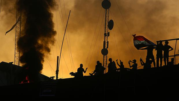 Protesters storm and burn the Basra government building (AP Photo/Nabil al-Jurani)