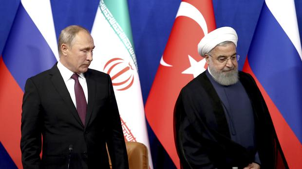 Vladimir Putin and Hassan Rouhani(AP Photo/Ebrahim Noroozi)