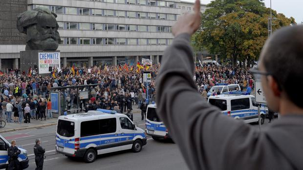 Protests erupted on the streets of Chemnitz after a German man was killed (Jens Meyer/AP)