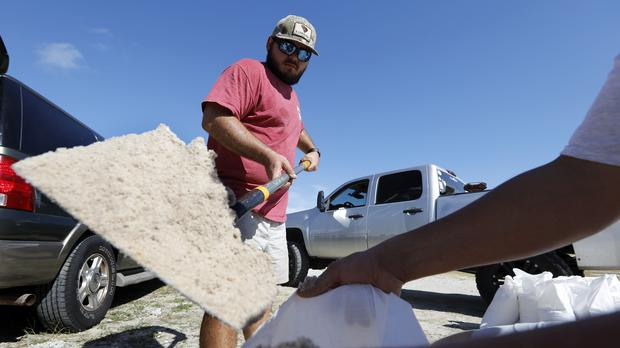 Residents in South Carolina fill sand bags (AP Photo/Mic Smith)