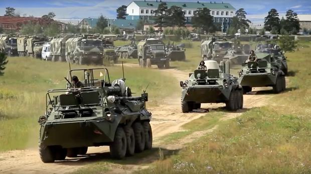 Russian armoured personnel carriers (Russian Defense Ministry Press Service pool photo via AP)