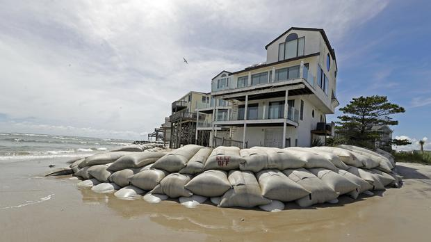 Sand bags surround homes on North Topsail Beach, North Carolina as Hurricane Florence approaches (Chuck Burton/PA)
