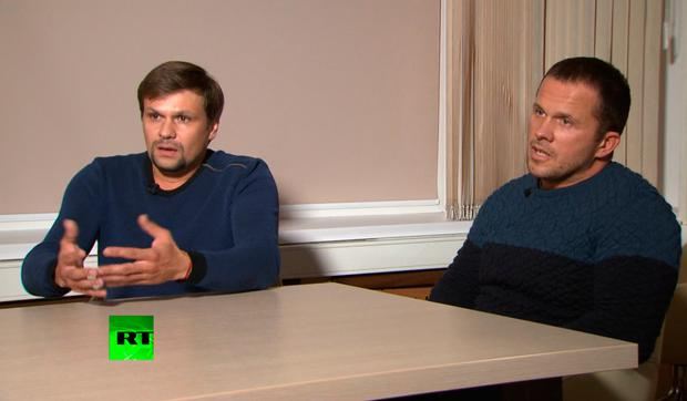 TV denials: Ruslan Boshirov, left, and Alexander Petrov speak with the Kremlin-funded RT channel in Moscow. PHOTO: AP