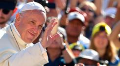 Pope Francis waves at the public as he arrives to lead his weekly general audience at the Saint Peter's square, in Vatican, on September 12, 2018. (Photo by Tiziana FABI / AFP)TIZIANA FABI/AFP/Getty Images