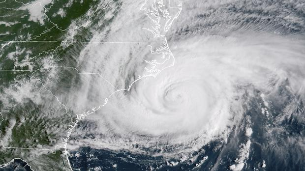 A satellite image shows Hurricane Florence hitting the east coast of the US (NOAA/AP)