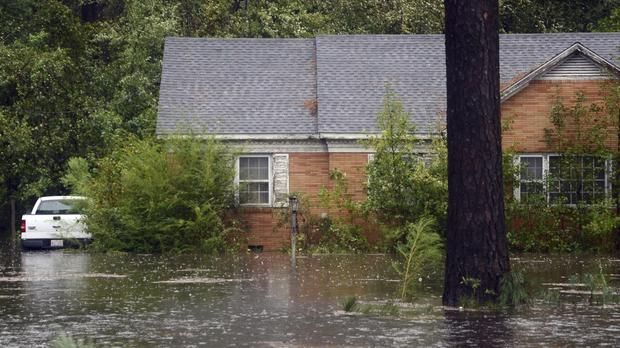 The hurricane was downgraded to a tropical storm but flooding is now a major issue in North Carolina (Janet S. Carter/Daily Free Press via AP)