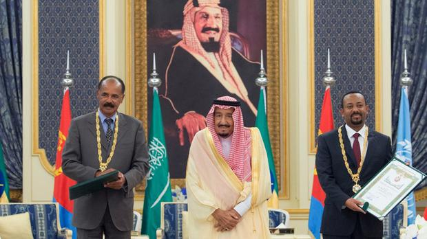 Saudi King Salman, centre, receives Eritrean president Isaias Afwerki, left, and Ethiopian prime minister Abiy Ahmed, right, in Jeddah (AP)