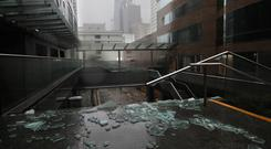 Broken glass from windows caused by Typhoon Mangkhut in Hong Kong (Vincent Yu/AP)