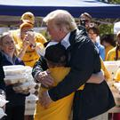 President Donald Trump hugs a young man (Evan Vucci/AP)