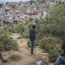 Sub-Saharan migrants aiming to cross to Europe take shelter in a forest overlooking the neighbourhood of Masnana, on the outskirts of Tangier, Morocco (Mosa'ab Elshamy/AP)