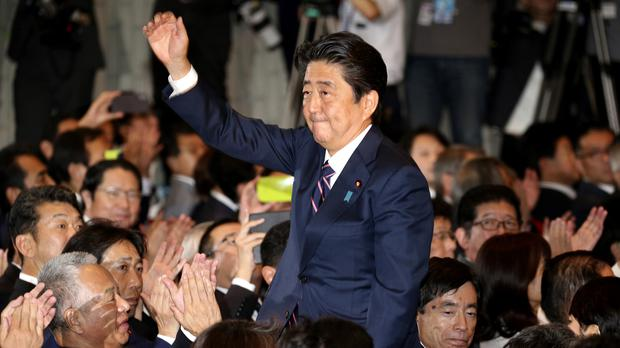 Shinzo Abe acknowledges applause from party members after fending off a leadership challenge (Koji Sasahara/AP)the LDP lawmakers shortly after his name was called as the winner of the ruling party presidential elections at its headquarters in Tokyo, Thursday, Sept. 20, 2018. Prime Minister Abe was re-elected Thursday to a third term as leader of the ruling party, paving the way for him to serve as prime minister for up to three more years. (AP Photo/Koji Sasahara)