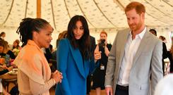 'Embraced': Meghan Markle and Prince Harry with her mother, Doria Ragland, (left) at the launch of the cookbook. Photo: PA