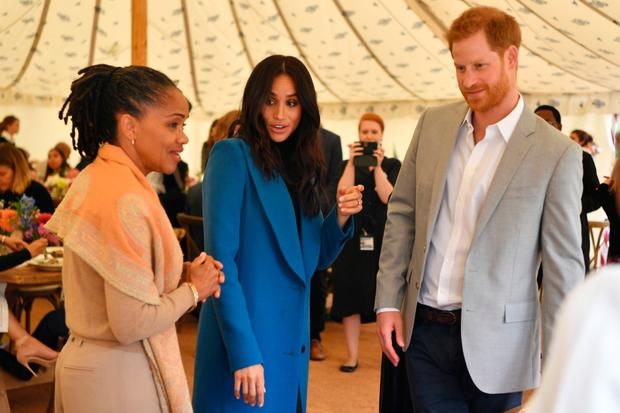 Duchess of Sussex takes mother to Grenfell book launch as surprise guest