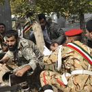Iranian armed forces members and civilians take shelter during the attack (ISNA, Behrad Ghasemi/AP)