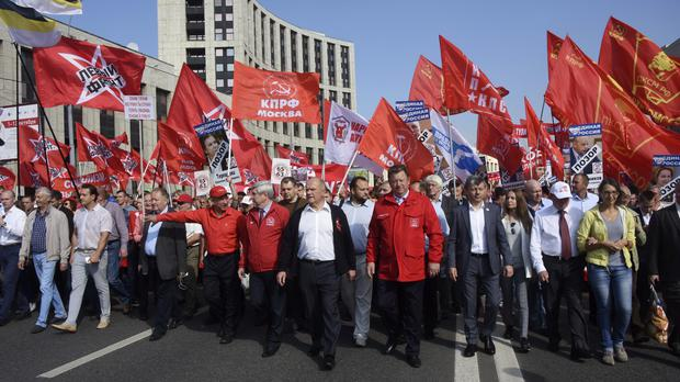 Communist Party leader Gennady Zyuganov, centre, joins a Moscow rally against raising the pension age (AP)