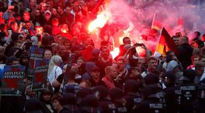 German police struggle with protestors and counter-demonstrators in Chemnitz, where a wave of right-wing populism has even led to murder