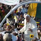 Pope Francis greets people as he arrives for a Mass at Santakos Park, in Kaunas, Lithuania (AP Photo/Mindaugas Kulbis)