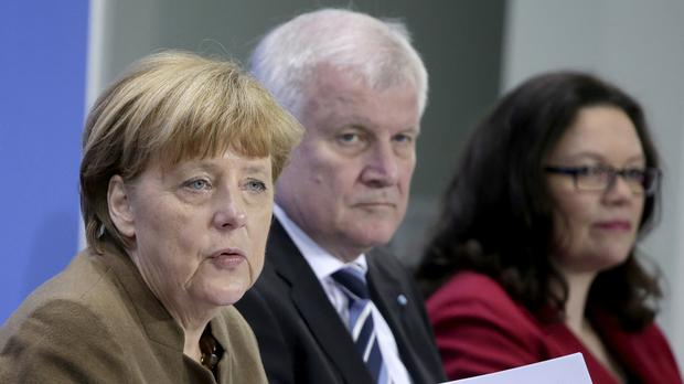 Angela Merkel, Horst Seehofer and Andrea Nahles (AP Photo/Michael Sohn)