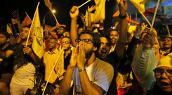 Supporters of Maldives' opposition presidential candidate Ibrahim Mohamed Solih celebrate their victory in Male (Eranga Jayawardena/AP)