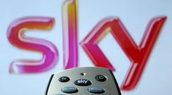 Sky urged investors to support Comcast's takeover, but the boost to its shares could not pull the FTSE out of the red (PA)