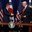 President Donald Trump and South Korean President Moon Jae-In participate in a signing ceremony (Evan Vucci/AP)