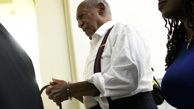 Bill Cosby is taken away in handcuffs (Mark Makela/Pool via AP)