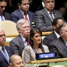 National security adviser John Bolton, centre, listens as President Donald address the United Nations General Assembly (Bebeto Matthews/AP)