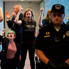 ANGER: Police look on as protesters are arrested in the Senate building during a rally against Brett Kavanaugh in Washington last week. Photo: Andrew Caballero/Getty