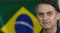 Jair Bolsonaro had 46% of the vote, latest poll figures showed (Silvia Izquierdo/AP)