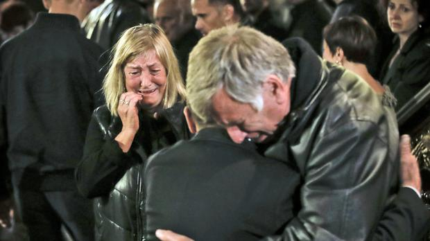 A woman identified as the mother of Viktoria Marinova cries during a service prior to her daughter's funeral (Vadim Ghirda/AP)