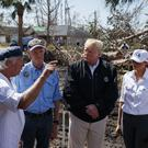 Donald and Melania Trump in hurricane-hit Lynn Haven, Florida (Evan Vucci/AP)