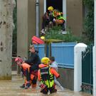 Firefighters evacuate youngsters from floods in Trebes, France. Photo: AFP/Getty