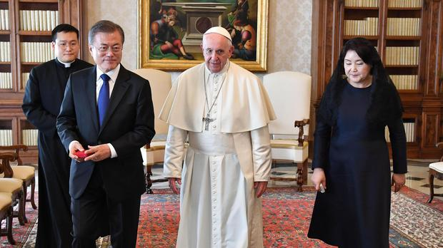 South Korean President Moon Jae-in and his wife Kim Jung-sook, right, meet Pope Francis (Alessandro Di Meo/AP)