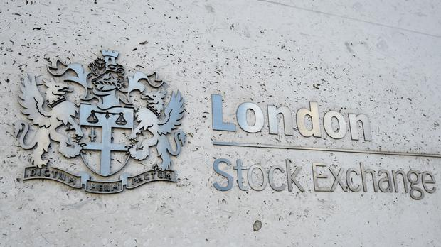 The FTSE 100 closed down (PA)