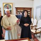 South Korean President Moon Jae-in and his wife Kim Jung-sook, right, listen to Pope Francis (Alessandro Di Meo/Ansa/AP)