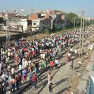 Crowds at the scene of Friday's train accident in Amritsar, India (Prabhjot Gill/AP)