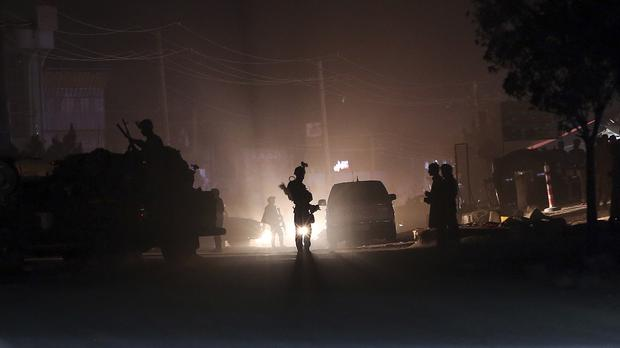 Security forces block the main road at the site of a suicide attack during the first day of parliamentary elections in Kabul, Afghanistan (AP Photo/Massoud Hossaini)
