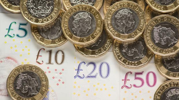 The pound fell against the dollar (PA)