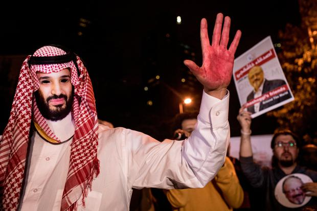 Red-handed: A protester dressed as Saudi Crown Prince Mohammed Bin Salman during a vigil for Jamal Khashoggi in Istanbul. Photo: Chris McGrath/Getty