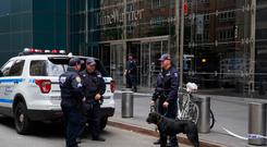 Target: Police at the Time Warner building in New York, where CNN has its HQ